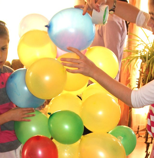 Birthday Party Balloon Tower Game:    Divide children into two teams. Give each team around forty or fifty balloons and a roll of packing tape. The team that builds the highest balloon tower using only the balloons and tape wins. Happy building!