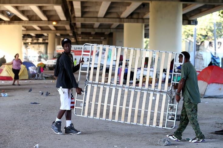"""Deep Cleansing"" of Houston homeless encampment underway by city.... Police, garbage trucks and a team of city workers arrived at sunrise Wednesday for what Mayor Sylvester Turner called a ""deep cleansing"" of the homeless encampment in Midtown under the Interstate 69 bridge."