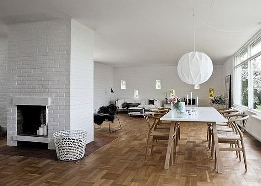 painted brick, wishbone chairs, gorgeous light, wall of mini windows, airy space... i adore this room/s