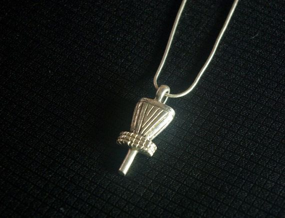 I designed this Disc Golf basket pendant to show my love and appreciation for the sport. Unfortunately there are very few designers making quality and affordable designs for the community of players. This is he first design in the series. its available in sterling silver and brass.