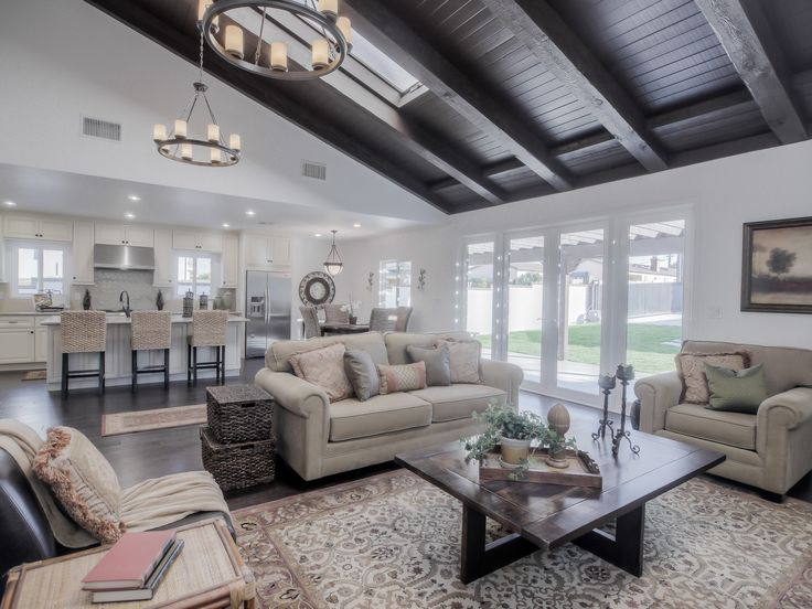 Open Floor Plan (Living Area leading into Kitchen and Dining Area) Wood ceiling