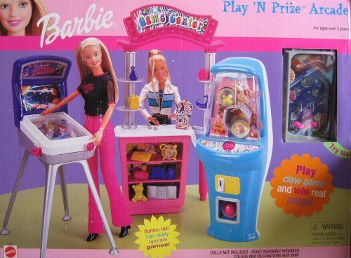 "Barbie Play 'N Prize Arcade Playset (2000) by Mattel. $114.99. Barbie Play 'N Prize Arcade is a 2000 Mattel production. Model #67264. Included in the box is a Gift Counter, a real working Pin Ball Machine with lights & sounds, a real working Claw Game Machine, Pieces & Accessories. All included items are pretend & intended for Barbie & 11.5"" size Fashion Dolls; Dolls are NOT included. Children can play with the included games! Barbie doll can really operate Games! (w..."