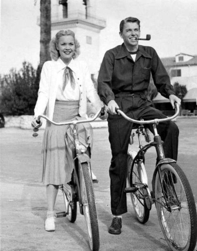 Ronald Reagan and his first wife, Jane Wyman, get some exercise.  Maybe to counteract the effects of smoking?