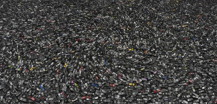 Chris Jordan works with the debris we as a society leave behind, photographing massive dumps of cell phones, crushed cars and circuit boards...  (This is a photo of discarded cell phones.)