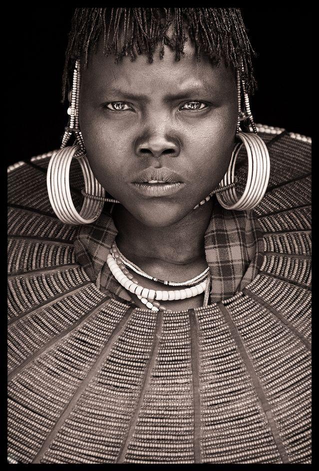"Portrait from 'Northern Kenya'  by John Kenny  courtesy of john-kenny.com  ""Twenty images from remote societies in the far north of Kenya, including the Samburu, Rendille, Turkana and Pokot."
