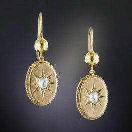 Original mid-19th-century Victorian ear drops designed as puff-backed, beaded-bordered oval plaques hand fabricated in 9ct. gold (hence of British origin) centered with glittering star-set rose-cut diamonds. 1 1/4 by 1/2 inch, 15ct. ear wires. Classics.