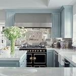 kitchens - blue kitchen cabinets iridescent tiles backsplash blue kitchen island pot filler farmhouse sink twin dishwashers white tone countertops La Cornue CornueFe Range