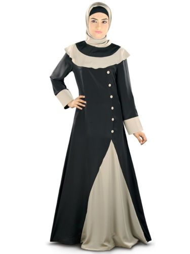 Beautiful dual color Abaya at MyBatua with stylish fabric layer attached at shoulder and side panel with fabric detailing, a classy dress best suited for evening wear  Round neckline with contrast fabric attached at yokeline. Contrast warm grey fabric panel at one side with fabric buttons Straight sleeves Utility pockets on both sides Matching Square Hijab (100x100 cm approx.) and Band can be bought separately.