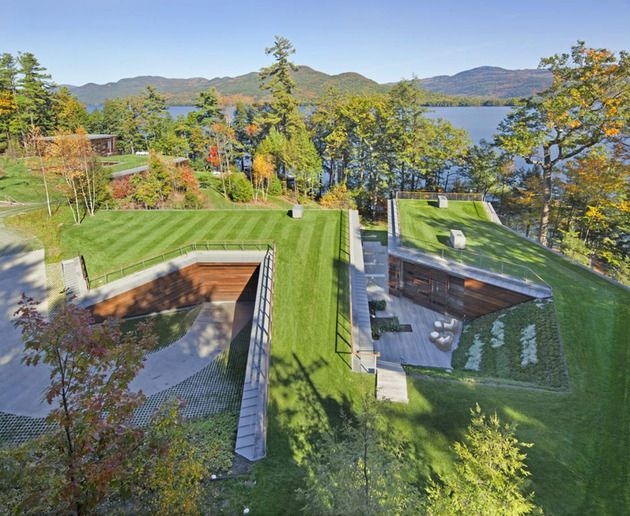 Partially buried lake house with rooftop garden