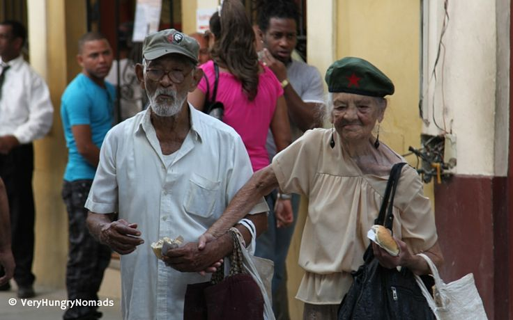Older couple hand in hand on the streets of Havana, Cuba - People we meet travelling