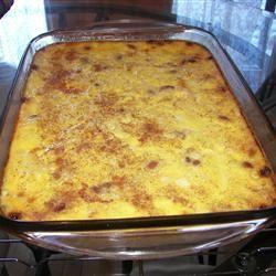 Baked Rice Pudding With White Rice, Water, Eggs, Milk, White Sugar, Vanilla Extract, Salt, Raisins, Ground Nutmeg