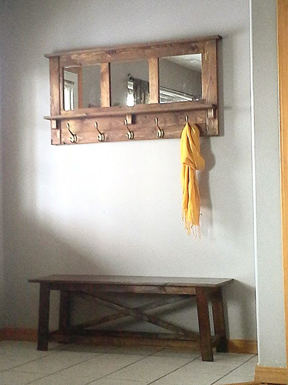 Rustic coat rack made from 3/4 pine with 3 12 x 12 mirrors, 5 heavy duty coat hooks and a shelf to add your personal decor. The piece is 49 1/2 inches wide 24 inches tall, it stands 5 3/4 inches off the wall with 3 3/4 inches of that being the shelf. I stain with a min wax finish and seal with polyurethane for a durable finish. My coat rack is easy to hang and very sturdy using a french cleat system we supply with the rack. I build these to order please allow 3-4 weeks for shipping.
