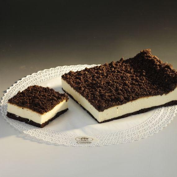 Sernik czekoladowy Czekoladowe, miękkie ciasto ucierane, z pokaźną warstwą pulchnego, wilgotnego sera śmietankowego. Wszystko dokładnie przykryte chrupiącą kruszonką czekoladową. Nie skończysz na jednym kawałku...