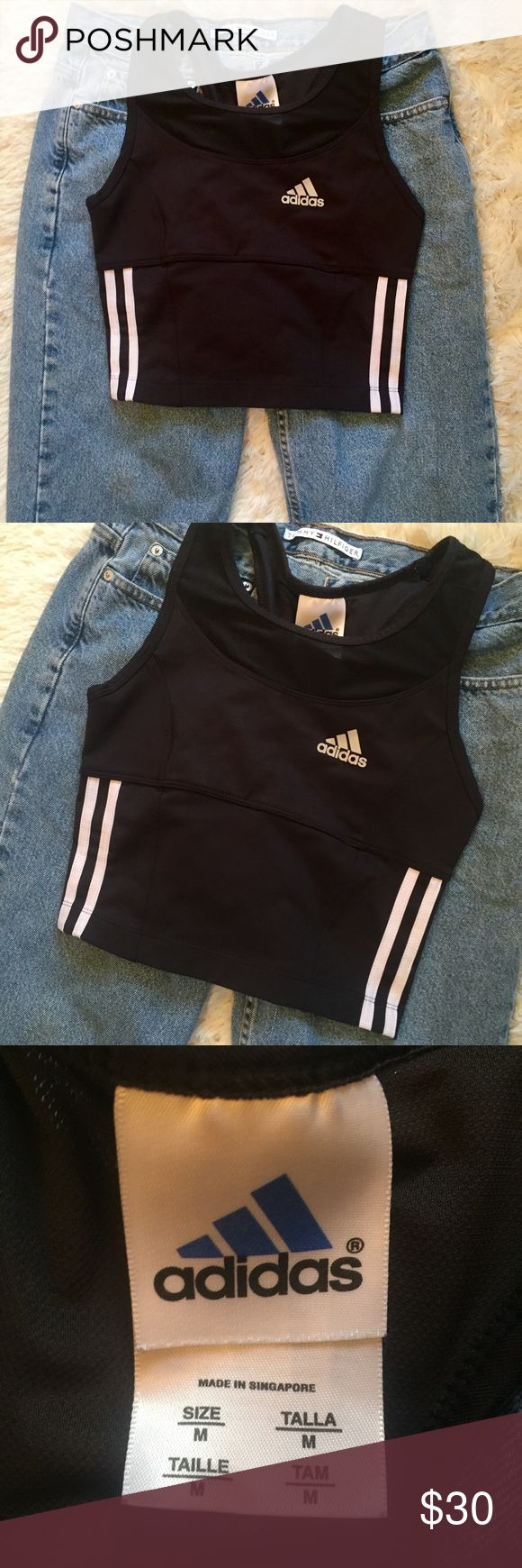 """Adidas Black & White Crop top bra top medium Adidas Climalite black and white crop top bra top. In excellent condition! Size medium. Measurements; 14"""" pit to pit (stretchy), length 16"""". As seen on celebrities such as Kylie Jenner! Reasonable offers always accepted. adidas Tops Crop Tops"""