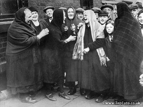 Shawls and clogs, good humour and good neighbourliness. This group of Lancashire mill girls typifies the spirit of the cotton mills.  Undated