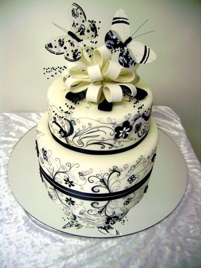 Very cute! I would probably put a different cake topper on instead of the butterflies. Maybe something simple because the cake is so detailed.