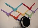 Paint and mount clothes hangers on the wall for fun coat hooks