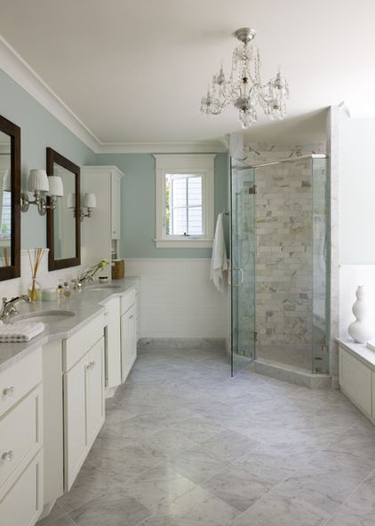 Crown molding painted in Benjamin Moore's White Dove OC17 and Arts and Crafts–style window trim contrast beautifully with Palladian Blue walls.