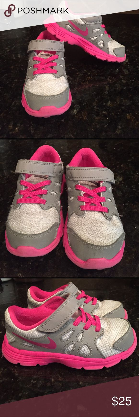 Girls Nike revolution 2 shoes size 10 Cute pair of girls gray and bright pink Nike shoes size 10. Worn only a few times. Pics don't do them justice. See pics for exact condition. From clean   smoke free home. Nike Shoes