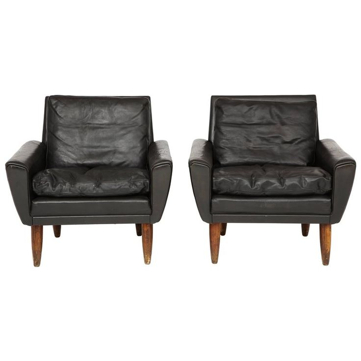 Pair of Midcentury Black Leather Chairs from France | From a unique collection of antique and modern chairs at https://www.1stdibs.com/furniture/seating/chairs/