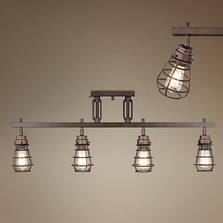 An industrial-inspired four light track light fixture in rich oil-rubbed bronze finish.