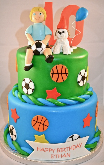 Sports themed cake with edible soccer figure and fondant dog