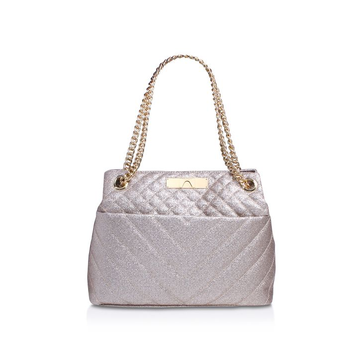 Gold Tote Bag. Indulge in a spot of daytime glam with Kurt Geiger London's new Lurex Kensington Tote. Just the right size for your daily effects, this luxe handbag's shimmering, quilted shell is trimmed with gleaming gold-tone hardware.