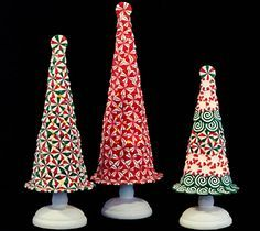 Enjoy the sweetness of the season when you decorate your home with this set of three peppermint trees by Valerie Parr Hill. QVC.com