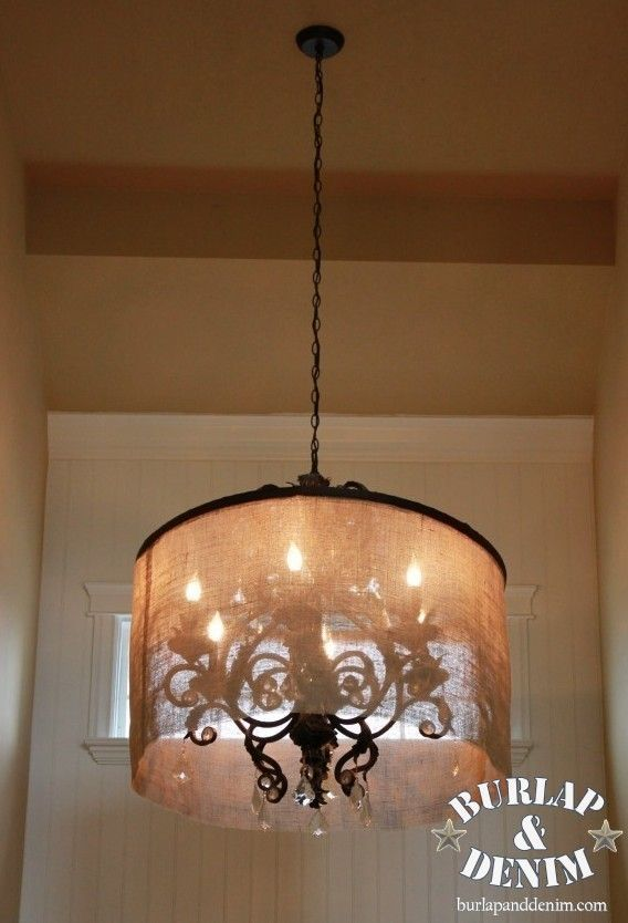 A DIY shade made from burlap and a HULA HOOP totally modernized this dated chandelier