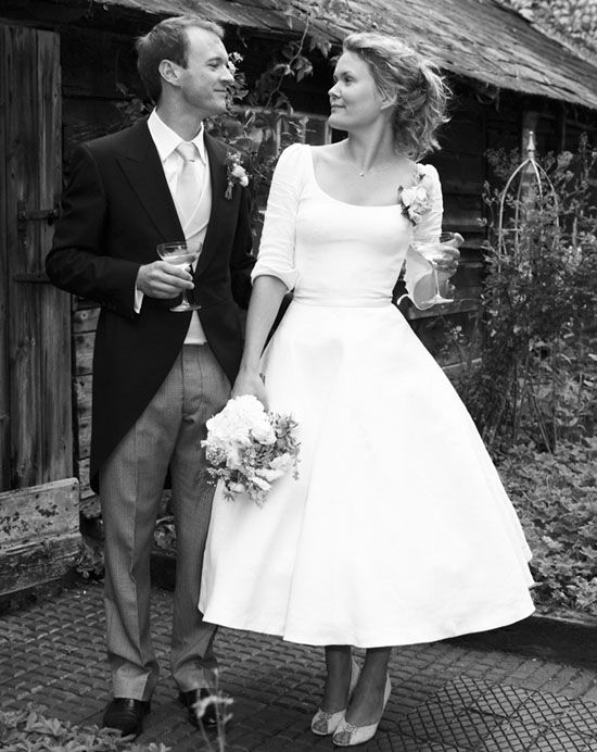 Antique Linen Wedding Dress by Sarah Treble. Antique French linen. Close fitting bodice with sleeves and turned back cuffs, nipped in waist and a full swinging skirt with net petticoats and hoops. Vintage buttons, antique silk sash and corsage.