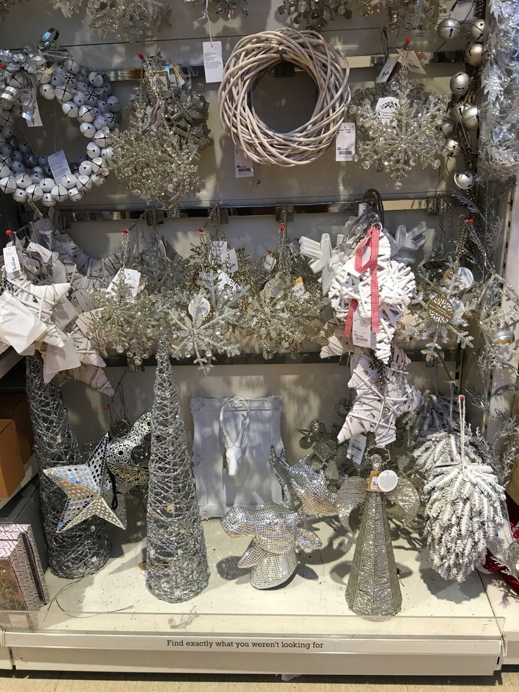 Christmas display - Free standing metal shelving with chrome back bars and forward facing arms - can be replaced with solid shelves. #shelving #hangingbars #shopfittings