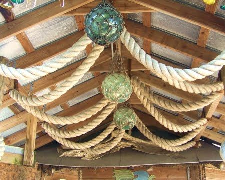 glass floats hanging from ceiling in restaurant
