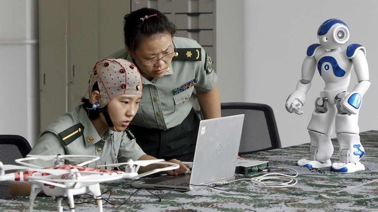 A student and instructor demonstrate using a headset to control robots with the girl's mind, at the PLA Information Engineering University in Zhengzhou, Henan province. Photo: Reuters