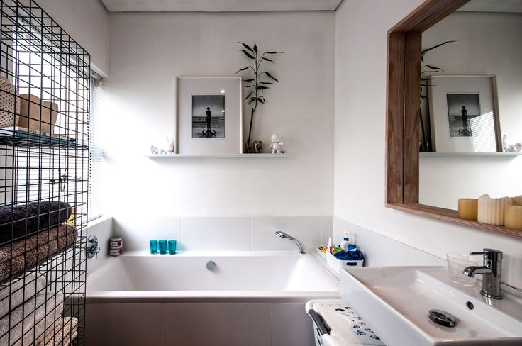 Spare bathroom floating shelf with lucky bamboo and photograph by Dook #askasheabode