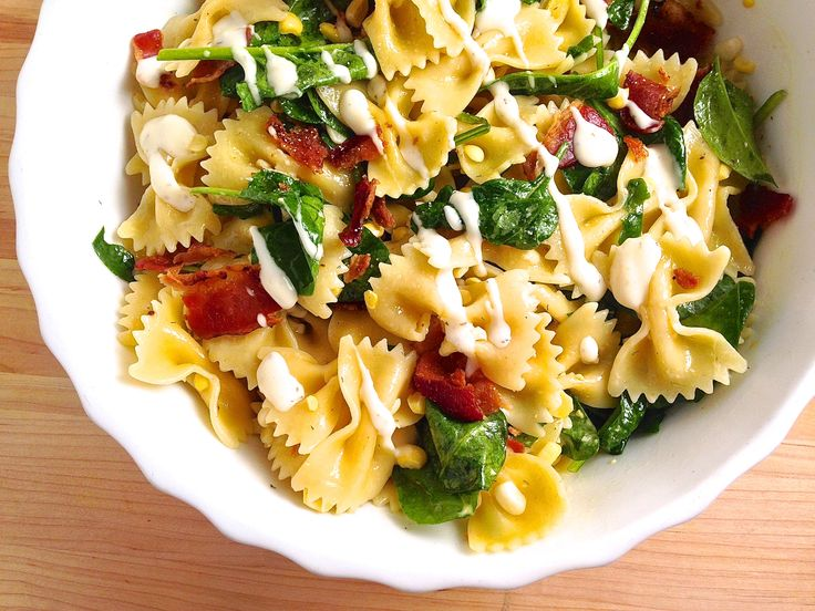 A bowtie pasta salad loaded with ingredients no one can resist. Get the Recipe: Bowties With Bacon, Corn, Spinach, and Ranch   - Delish.com