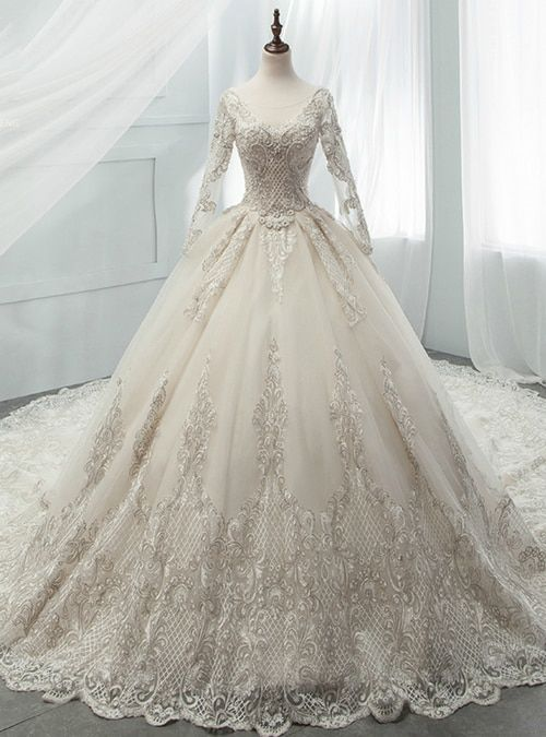 a2f7df4d ... gown Hemline:floor length Neckline:bateau Fabric:tulle Shown  Color:champagne Sleeve Style:long sleeve Back Style:lace up Embellishment: appliques beading