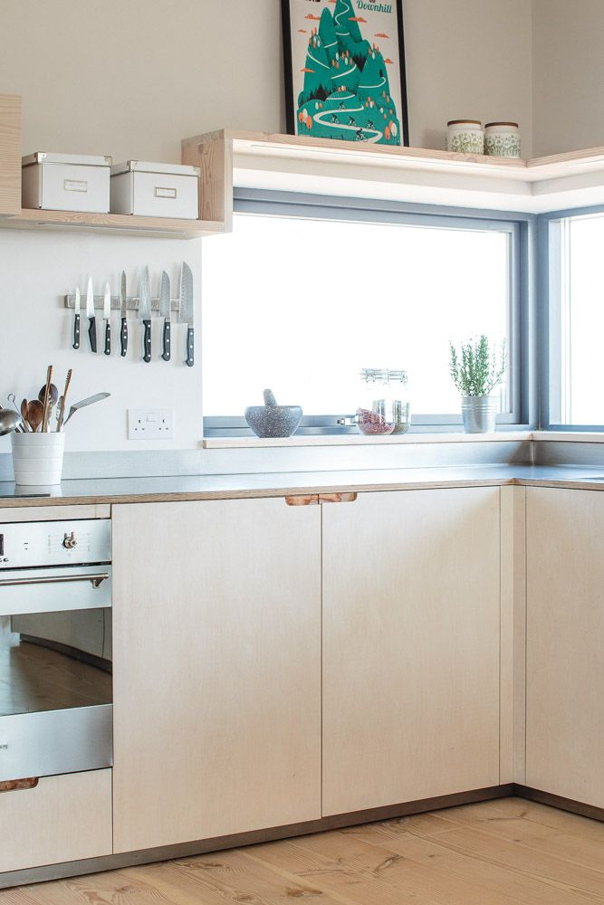 Sustainable Kitchens Eco Kitchen -Contemporary plywood kitchen with brushed stainless steel finish and lye treated cabinets with routed pulls. The Dinesen Douglas Fir flooring offcuts are utilised to make the floating shelving that is visible.