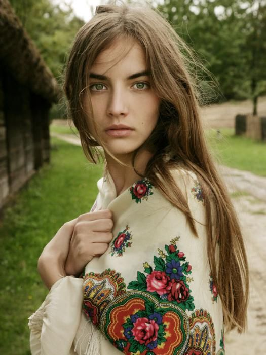Balkan girl wearing a flowered shawl