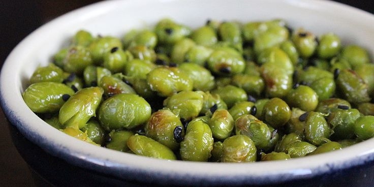1/2 cup = 110 calories  Shelled edemame, sprinkle with evoo bake for 12-15mins @ 450 dprinkle w/ seseme seeds and bake 5 more mins