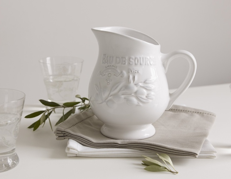 Pretty hand decorated water jug with an attractive distressed relief design.