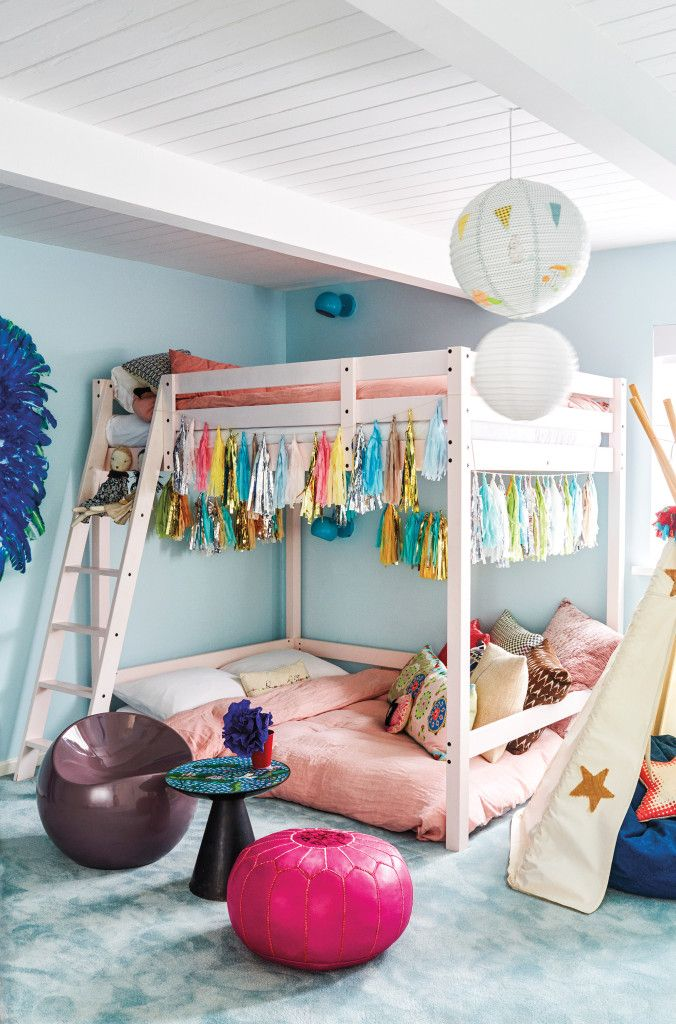 The girls' shared bedroom features an Ikea loft bed, turquoise reading lights from The Land of Nod, and pale robin's-egg Farrow & Ball paint in Blue Ground.