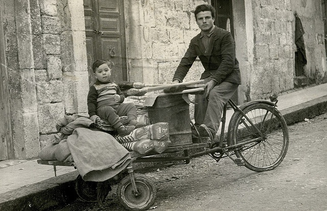 An original food truck! Black and white picture of man and child in Sicily in 1960
