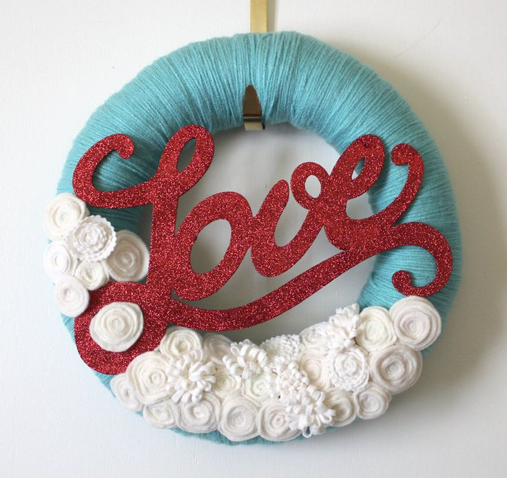 Love Wreath, Yarn and Felt Wreath, Valentine Wreath, 14-inch size. $45.00, via Etsy.