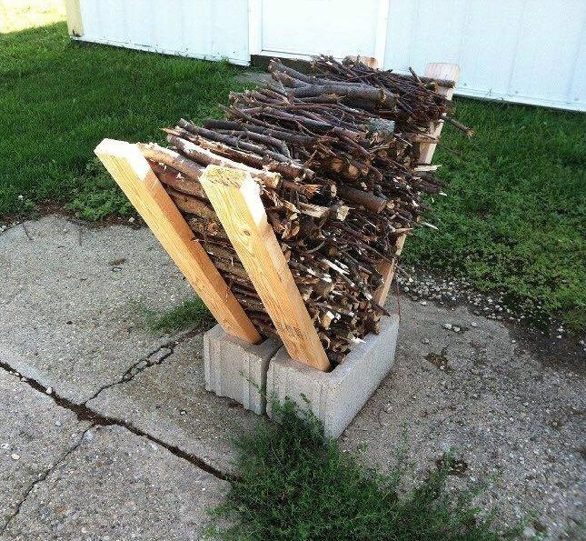 Great idea for storing firewood in a small space!!