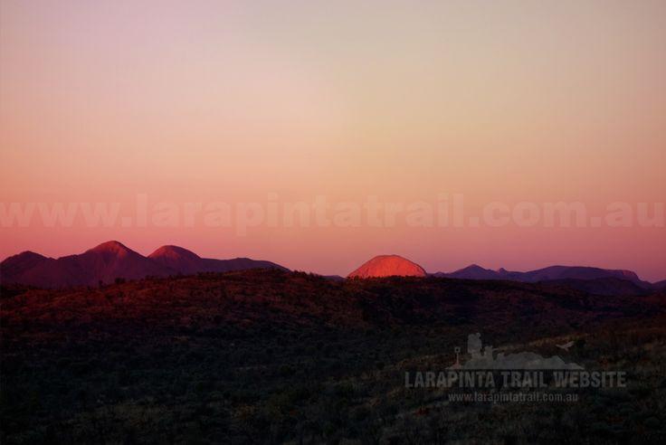 Brinkley Bluff glows in the distance during sunset. Shot taken from Section 6, Larapinta Trail. © Explorers Australia Pty Ltd (www.explorersaustralia.com.au)
