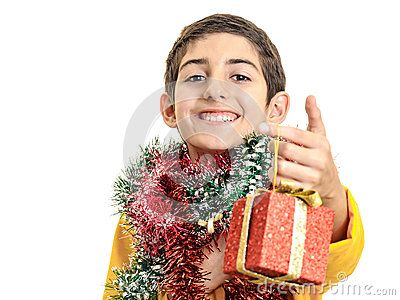 Download Confident Boy Giving Christmas Gift Royalty Free Stock Photo for free or as low as 0.69 lei. New users enjoy 60% OFF. 19,926,991 high-resolution stock photos and vector illustrations. Image: 35366275