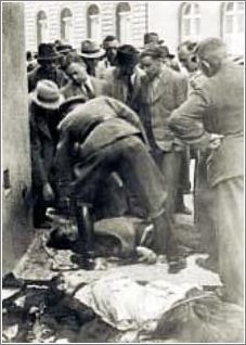 The dead paratroopers were carried out in front of the crypt, Karl Hermann Frank is bending over one of the corpses