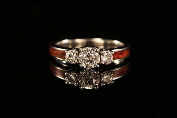 One of THE BEST ring makers in the world....I love his work! 14k Gold Three Stone Wood Engagement Ring by chasing victory