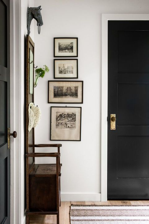 black doors, black and white historic prints, wood bench/mirror