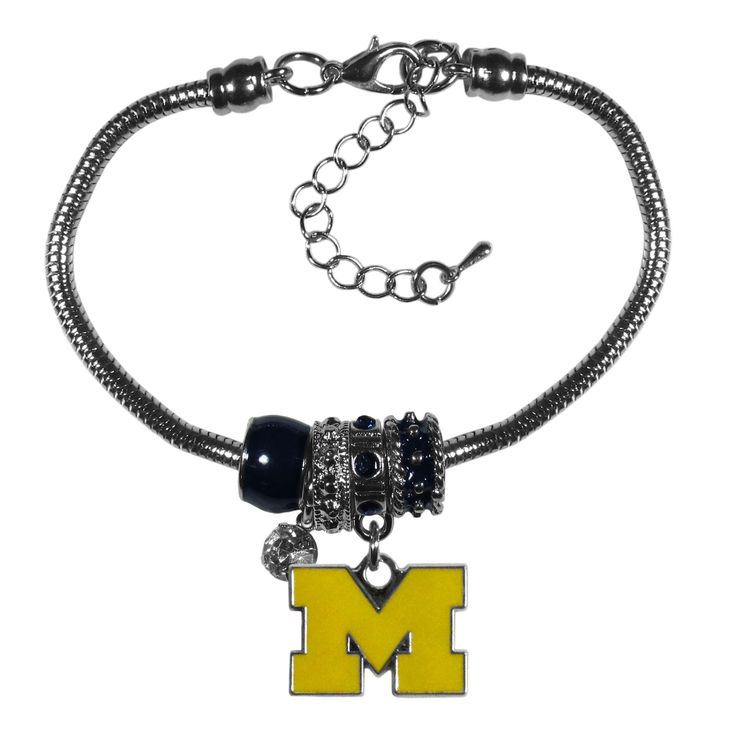 """Checkout our #LicensedGear products FREE SHIPPING + 10% OFF Coupon Code """"Official"""" Michigan Wolverines Euro Bead Bracelet - Officially licensed College product Combine your love of the game with the wildly popular Euro beads 4 Euro beads with a high polish team charm and rhinestone 7 inch snake chain bracelet with 2 inch extender Perfect gift for a Michigan Wolverines fan - Price: $19.00. Buy now at https://officiallylicensedgear.com/michigan-wolverines-euro-bead-bracelet-cbbr36"""